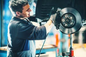 Man servicing a vehicle